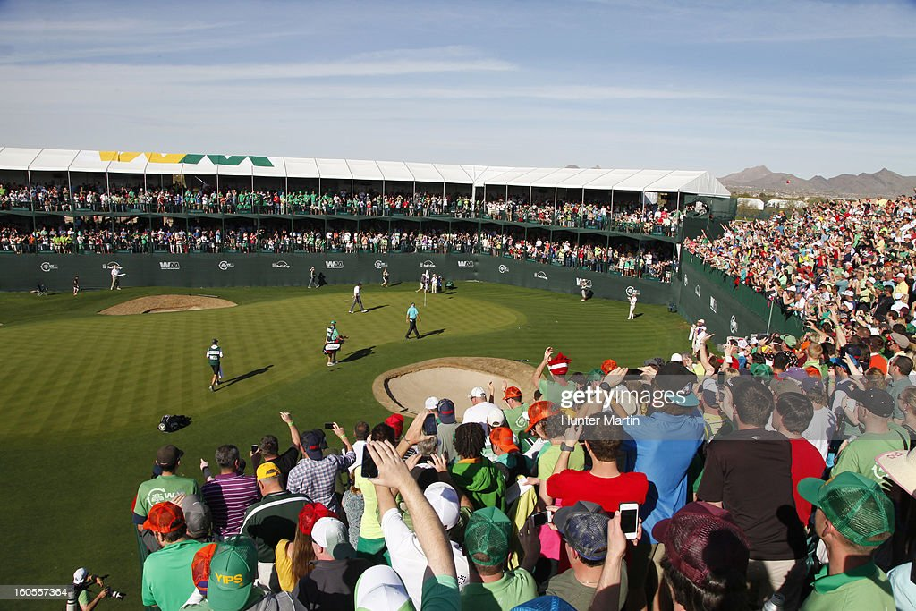 Fans cheer Phil Mickelson as he walks to his ball on the 16th green during the third round of the Waste Management Phoenix Open at TPC Scottsdale on February 2, 2013 in Scottsdale, Arizona.