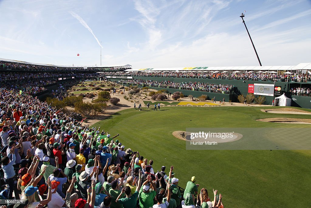 Fans cheer Phil Mickelson as he walks to the green on the 16th hole during the third round of the Waste Management Phoenix Open at TPC Scottsdale on February 2, 2013 in Scottsdale, Arizona.