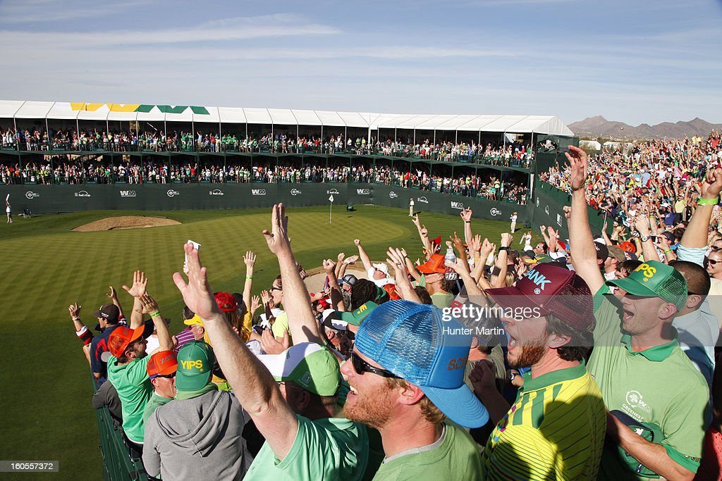 Fans cheer Phil Mickelson's near hole-in-one on the 16th hole during the third round of the Waste Management Phoenix Open at TPC Scottsdale on February 2, 2013 in Scottsdale, Arizona.