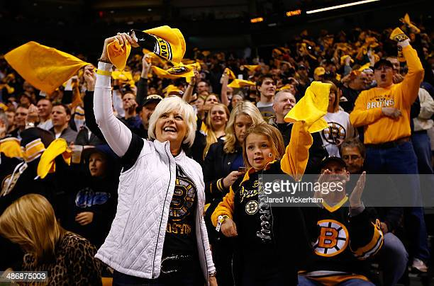 Fans cheer prior to the start of the game between the Boston Bruins and the Detroit Red Wings in Game Five of the First Round of the 2014 NHL Stanley...