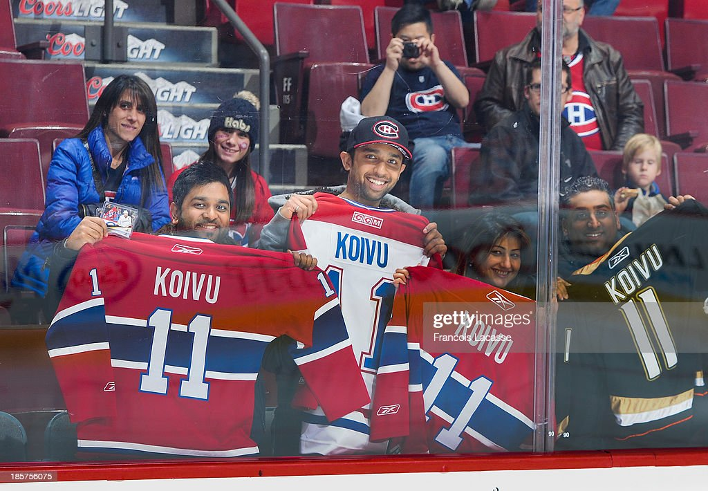 Fans cheer the Anaheim Ducks during the game against the Montreal Canadiens during the NHL game on October 24, 2013 at the Bell Centre in Montreal, Quebec, Canada.