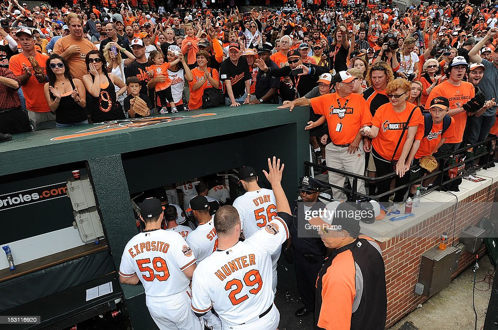 Fans cheer the Baltimore Orioles as they leave the field after a 6-3 victory against the Boston Red Sox at Oriole Park at Camden Yards on September 30, 2012 in Baltimore, Maryland.
