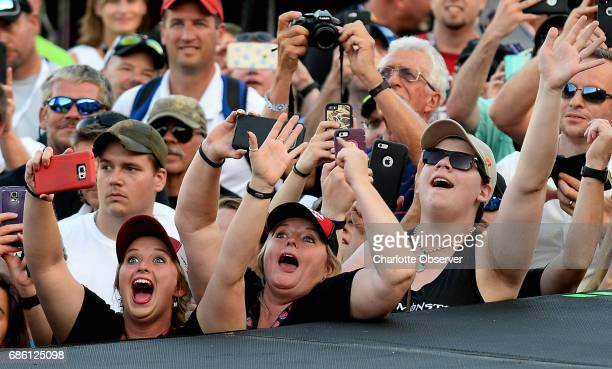 NASCAR fans cheer the drivers during driver introductions prior to the NASCAR Monster Energy AllStar Race on Saturday May 20 2017 at Charlotte Motor...