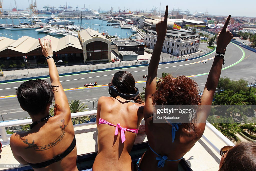 Fans cheer the field from a rooftop pool terrace during the European Grand Prix at the Valencia Street Circuit on June 24 2012 in Valencia Spain