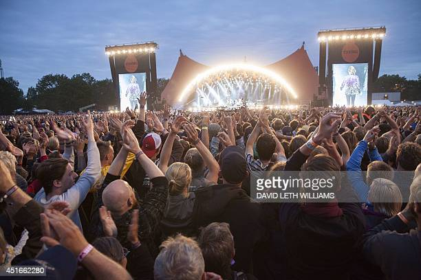 Fans cheer the Rolling Stones band performing on the Orange Stage at the Roskilde Festival 2014 on July 3 2014 in Roskilde Denmark AFP PHOTO /...