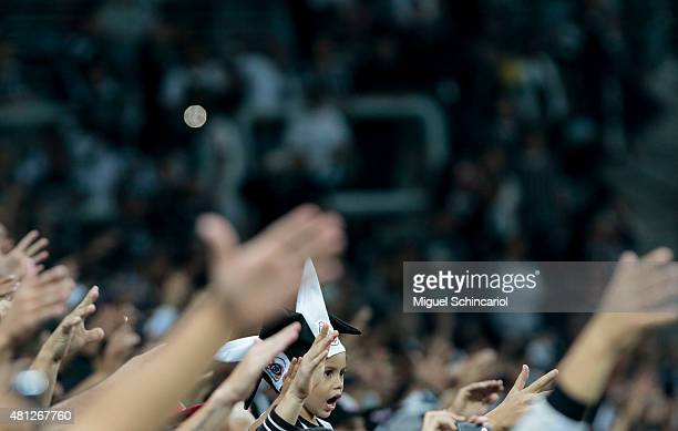 Fans cheer their Corinthians team before the start a match between Corinthians v Atletico MG of Brasileirao Series A 2015 at Arena Corinthians on...