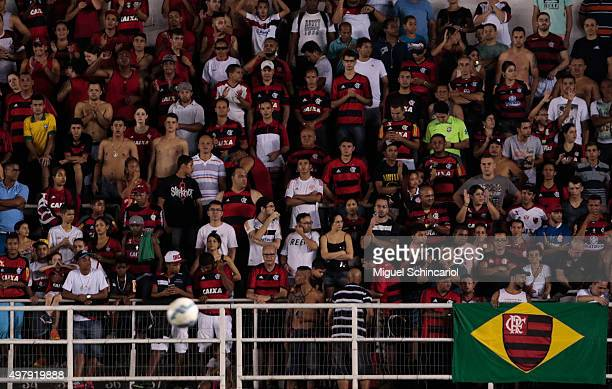 Fans cheer their Flamengo team during a match between Santos v Flamengo of Brasileirao Series A 2015 at Vila Belmiro Stadium on November 19 2015 in...