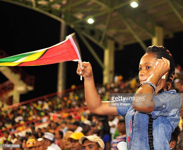 Fans cheer their team during the Seventh Match of the Cricket Caribbean Premier League between Guyana Amazon Warriors v St Lucia Zouks at Providence...