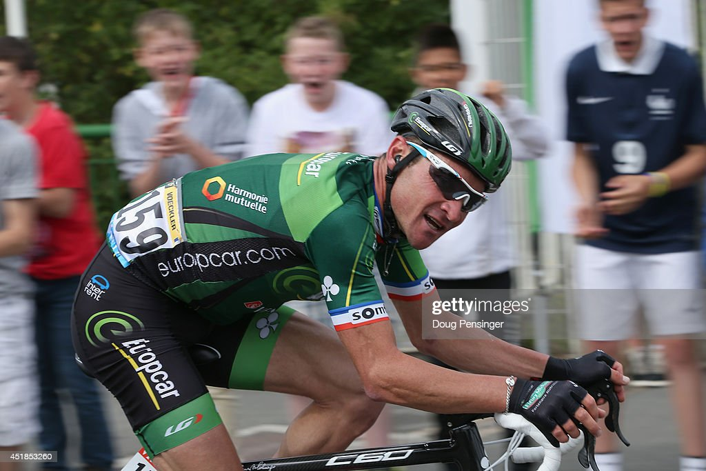 Fans cheer Thomas Voeckler of France and Team Europcar as he rides at the front of the race in a solo break away and was named the most combative...