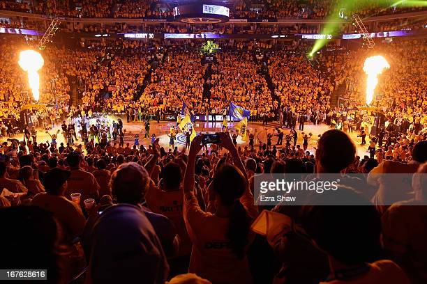 Fans cheer when the Golden State Warriors are introduced for their game against the Denver Nuggets during Game Three of the Western Conference...