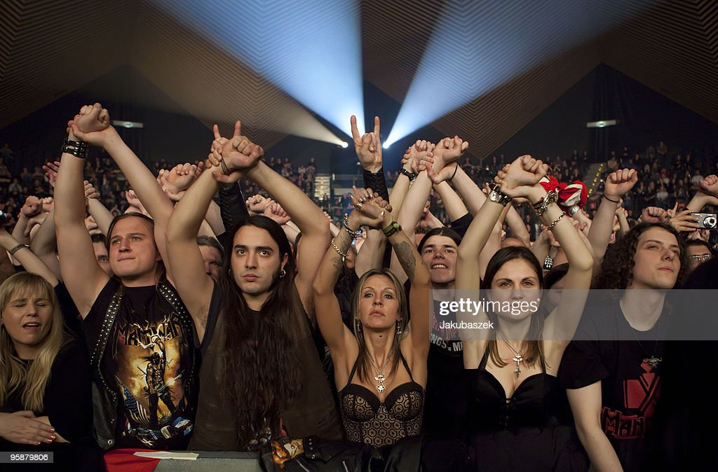 MANOWAR -SISTERS  OF THE WORLD Fans-cheer-while-the-usamerican-metal-band-manowar-performs-live-a-picture-id95879806