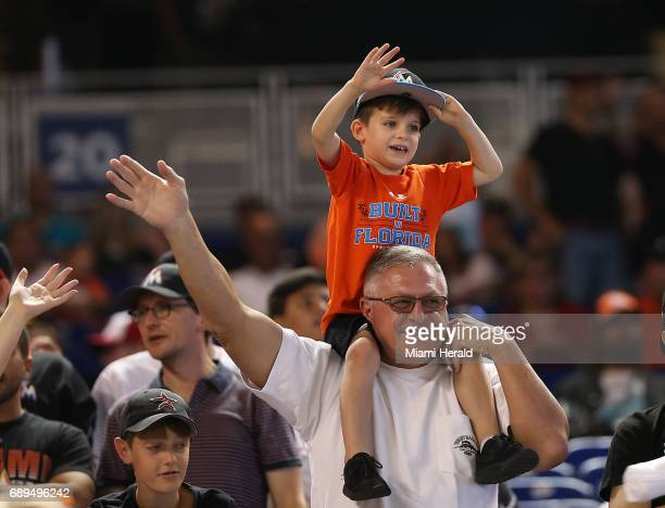 Fans cheere in the stands during a game between the Miami Marlins and the Los Angeles Angels on Sunday May 28 2017 at Marlins Park in Miami Fla