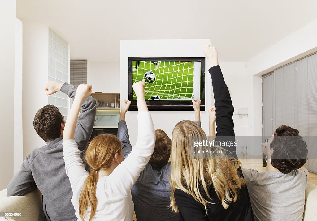 fans cheering world cup football on television