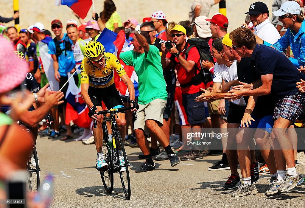 Fans cheers as current race leader and wearer of the Maillot Jaune, <a gi-track='captionPersonalityLinkClicked' href=/galleries/search?phrase=Chris+Froome&family=editorial&specificpeople=5428054 ng-click='$event.stopPropagation()'>Chris Froome</a> of Great Britain and SKY Procycling attacks to win the stage during stage fifteen of the 2013 Tour de France, a 242.5KM road stage from Givors to Mont Ventoux, on July 14, 2013 on Mont Ventoux, France.