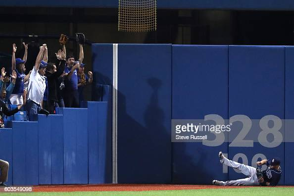 TORONTO ON SEPTEMBER 12 Fans cheers as Tampa Bay Rays left fielder Mikie Mahtook falls to the ground after Ezequiel Carrera's hit cleared the wall...