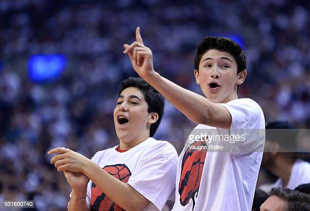 Fans cheers for the Raptors during Game Seven of the Eastern Conference Quarterfinals against the Miami Heat during the 2016 NBA Playoffs at the Air...