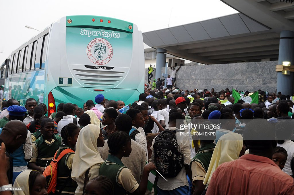 Fans cheers Nigerian football team as they arrive in Abuja on February 12, 2013. The newly crowned African champions Nigerian Super Eagles arrives in Abuja to a warm reception by fans and government officials after defeating Burkina Faso to win the 2013 African Cup of Nations in South Africa.