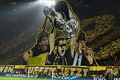 Fans cheers prior to the Round of 16 secondleg UEFA Champions League football match Borussia Dortmund vs Juventus in Dortmund western Germany on...