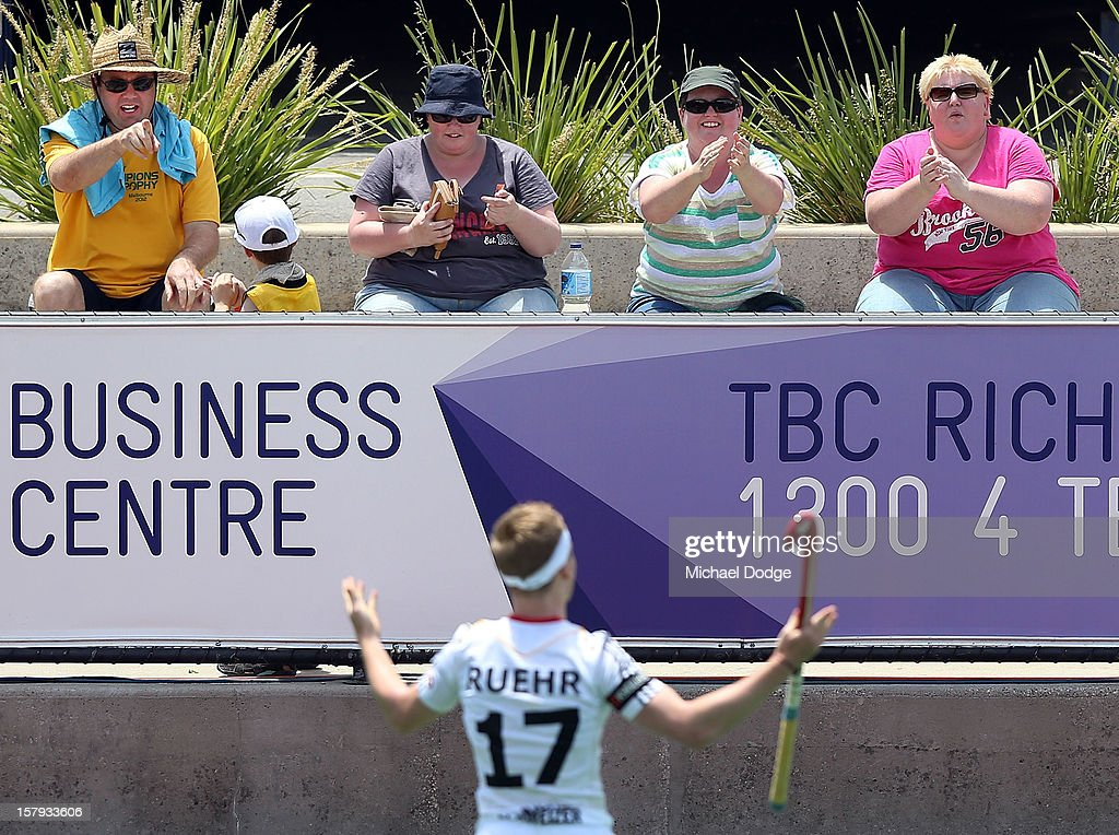 Fans clap Jan Christopher Ruehr of Germany who scored a goal in the match between New Zealand and Germany during day five of the 2012 Champions Trophy at the State Netball and Hockey Centre on December 8, 2012 in Melbourne, Australia.