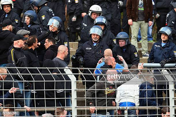 Fans clash with police forces during the Bundesliga match between SV Darmstadt 98 and Eintracht Frankfurt at MerckStadion am Boellenfalltor on April...