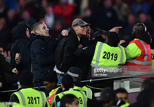 Fans clash with stewards during the EFL Cup fourth round match between West Ham United and Chelsea at The London Stadium on October 26 2016 in London...