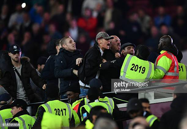 Fans clash with the police during the EFL Cup fourth round match between West Ham United and Chelsea at The London Stadium on October 26 2016 in...