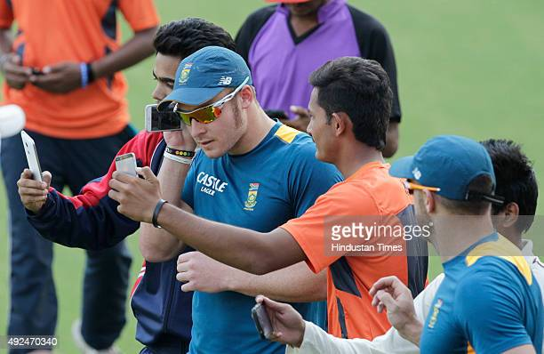 Fans clicking selfie with South African player David Miller during the practice session before the 2nd One Day cricket match against India at Ushabai...