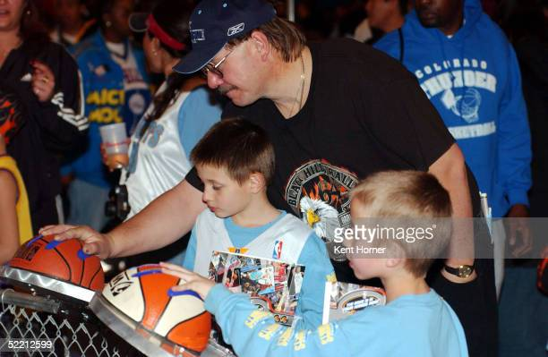 Fans compare their hand sizes to NBA players' during AllStar NBA Jam Session at the Colorado Convention Center during NBA AllStar weekend on February...