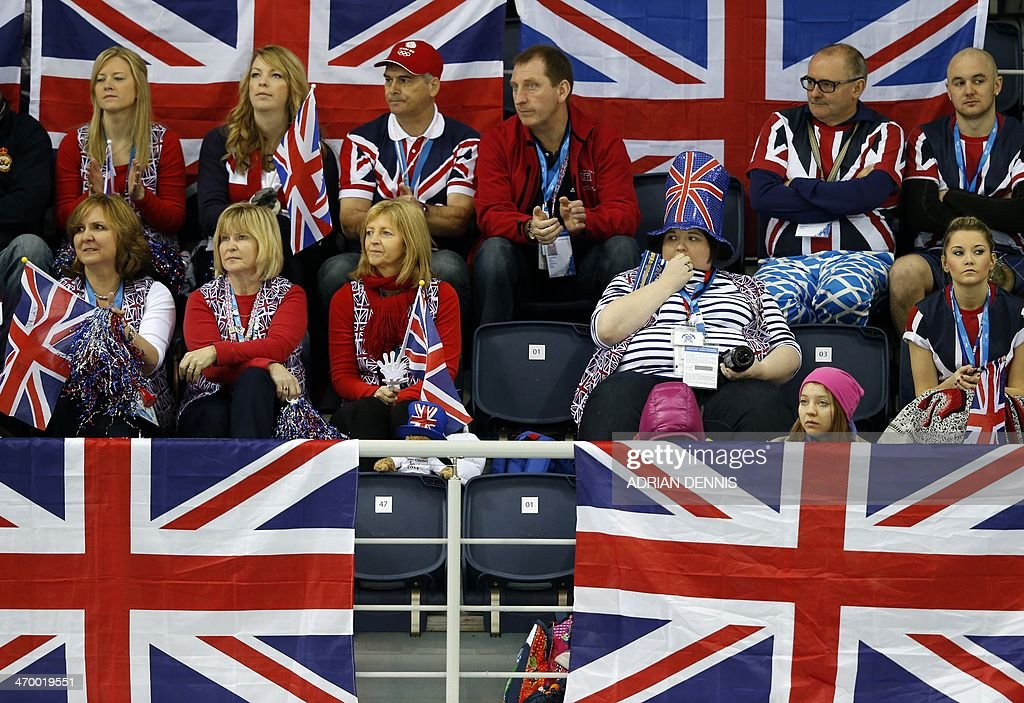 Fans concentrate on the game between Norway and Great Britain during the men's curling tie-breaker match between Great Britain and Norway at the Ice Cube curling centre in Sochi on February 18, 2014 during the 2014 Sochi winter Olympics. AFP PHOTO / ADRIAN DENNIS