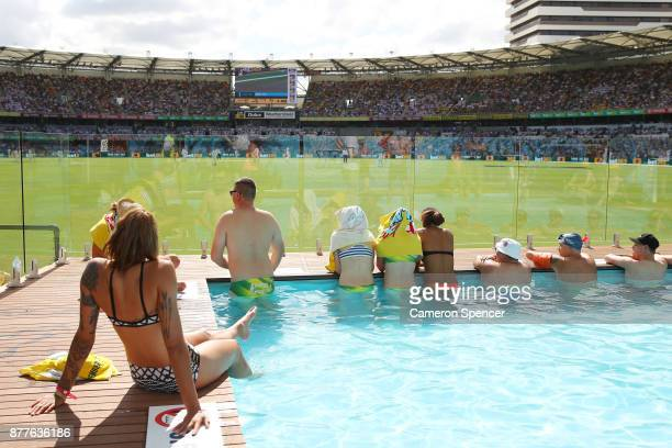 Fans cool off in the pool at the Gabba Pool Deck during day one of the First Test Match of the 2017/18 Ashes Series between Australia and England at...