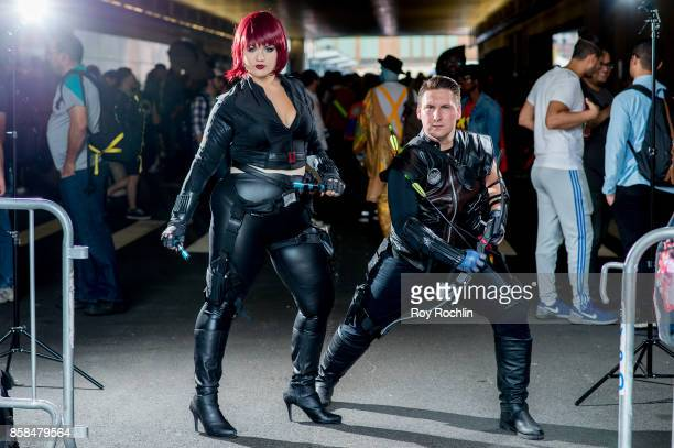 Fans cosplay as Black Widow and Hawkeye form The Avengers and the Marvel universe during 2017 New York Comic Con Day 2 on October 6 2017 in New York...