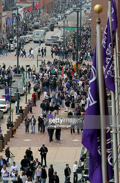 Fans crowd 20th and Blake Streets as they make their way to the stadium as the Philadelphia Phillies face the Colorado Rockies during MLB action on...