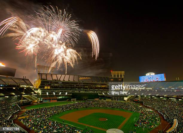 Fans crowd onto the field for fireworks after a game between the Oakland Athletics and the Los Angeles Angels of Anaheim at Oco Coliseum on June 19...