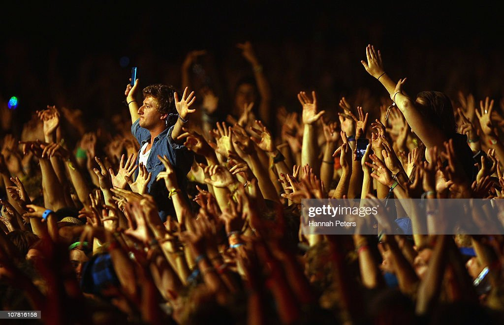 Fans crowd surf as Chase Status perform on the rhythm stage during day two on December 30 2010 in Gisborne New Zealand