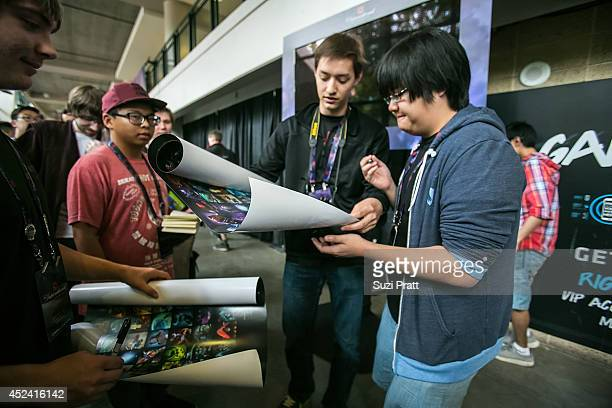 Fans crowd the hallways to wait in line to get items autographed by their favorite DOTA 2 players at The International DOTA 2 Champsionships at Key...