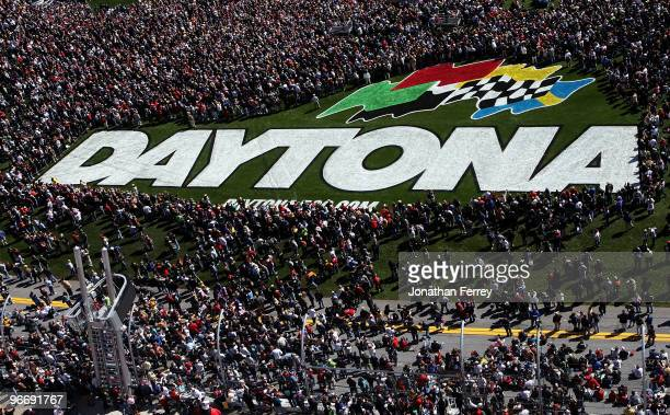 Fans crowd the infield trioval grass during prerace festivities before the NASCAR Sprint Cup Series Daytona 500 at Daytona International Speedway on...