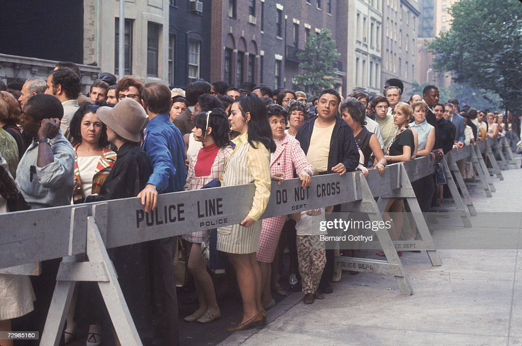 Fans crowd the police barricades along 81st Street in Manhattan to view the body of the late actress-singer Judy Garland at the Frank E. Campbell funeral home, New York, New York, June 26, 1969.