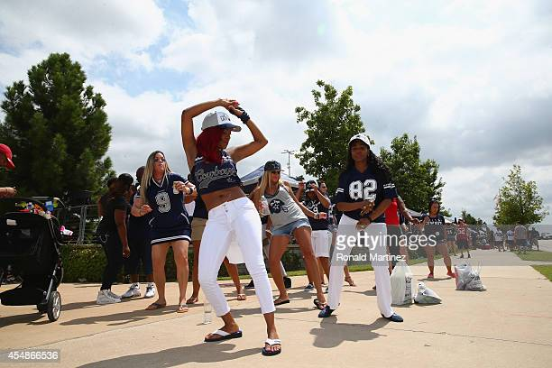 Fans dance in the parking lot before a game against the San Francisco 49ers and the Dallas Cowboys at ATT Stadium on September 7 2014 in Arlington...