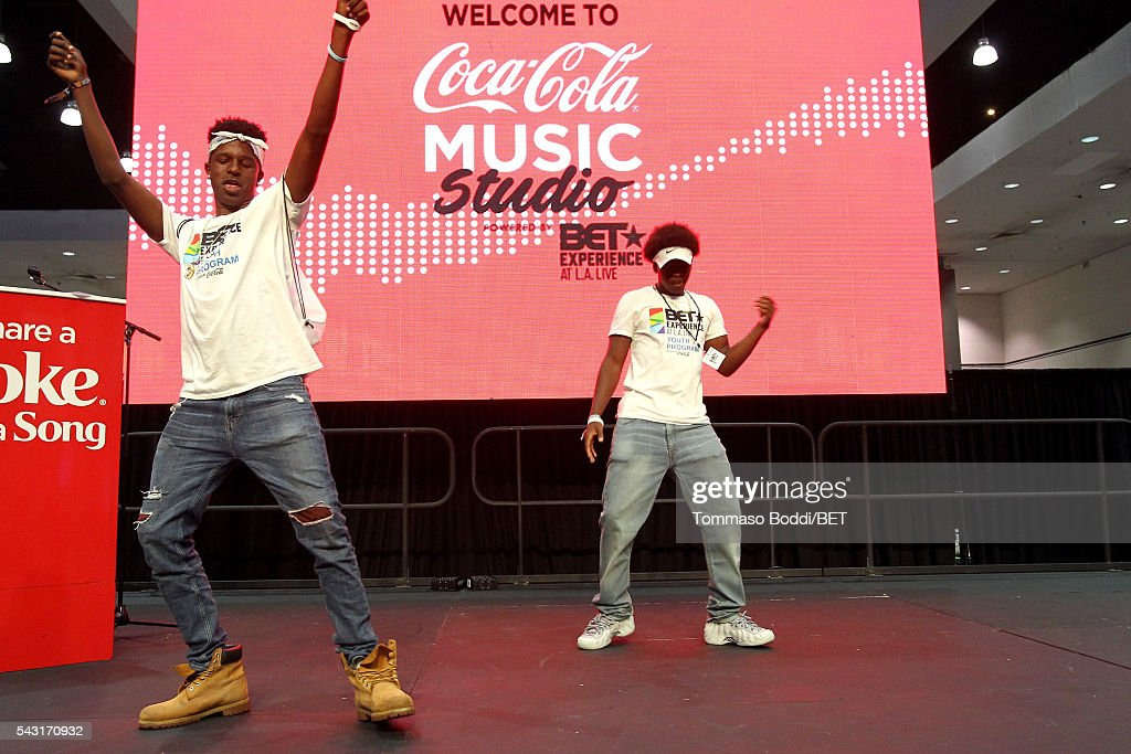 Fans dance onstage during the Coke music studio during the 2016 BET Experience on June 26, 2016 in Los Angeles, California.