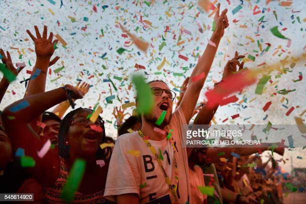 TOPSHOT Fans dance to the music of Australian band Tame Impala as colorful confetti are launched in the air during a concert at Alive Festival in...
