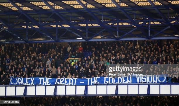 Fans display a banner in memory of former player Alex Young before the Premier League match at Goodison Park Liverpool