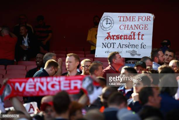 Fans display banners during the Premier League match between Arsenal and Everton at Emirates Stadium on May 21 2017 in London England