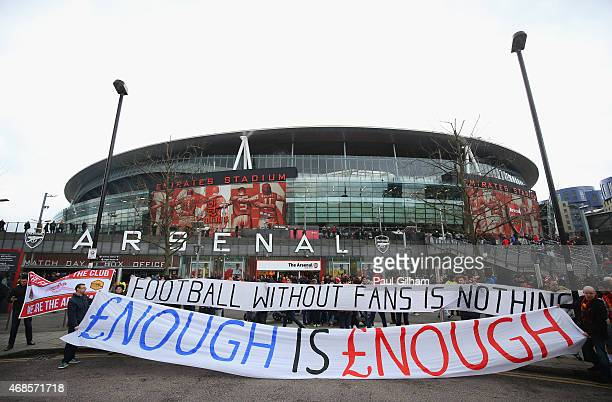 Fans display banners outside the ground prior to the Barclays Premier League match between Arsenal and Liverpool at Emirates Stadium on April 4 2015...