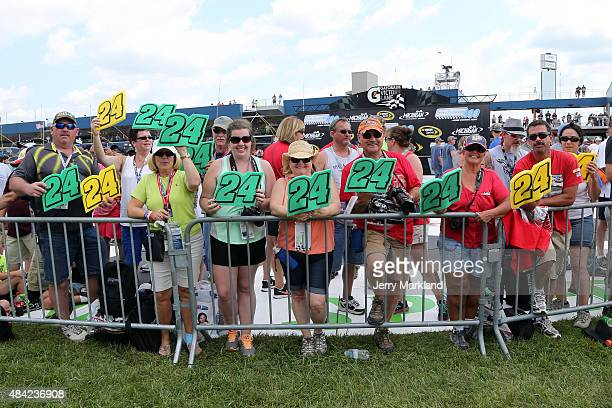 Fans display signs in support of Jeff Gordon driver of the Pepsi Chevrolet before the NASCAR Sprint Cup Series Pure Michigan 400 at Michigan...
