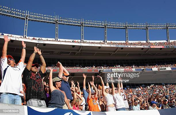 Fans do the wave as they watch the Denver Broncos face the Seattle Seahawks at INVESCO Field at Mile High on September 19 2010 in Denver Colorado The...