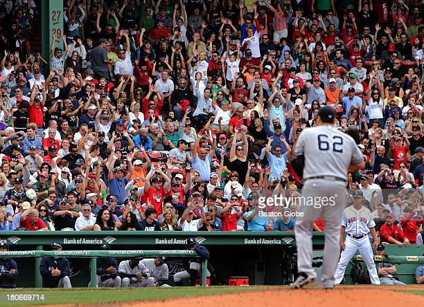 Fans do 'The Wave' with New York Yankees relief pitcher Joba Chamberlain on the mound in the seventh inning The Boston Red Sox take on the New York...