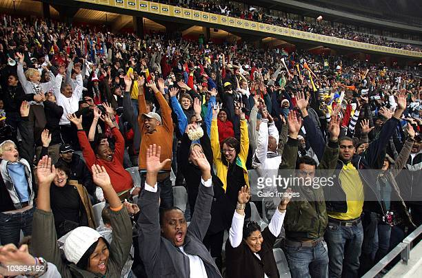 Fans doing the mexican wave2 during the Absa Premiership match between Vasco Da Gama and Orlando Pirates at Cape Town Stadium on August 27 2010 in...