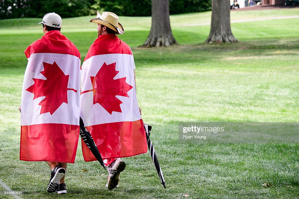 Fans draped in Canadian flags walk the course during the second round of the World Golf Championships-Bridgestone Invitational at Firestone Country Club on July 1, 2016 in Akron, Ohio.
