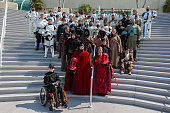 Fans dressed as characters from Star Wars gather for a group photo session at ComicCon International Day 3 on July 22 2016 in San Diego California