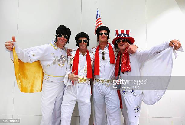 Fans dressed as Elvis show their support for USA after landing at Natal airport on June 16 2014 in Natal Brazil